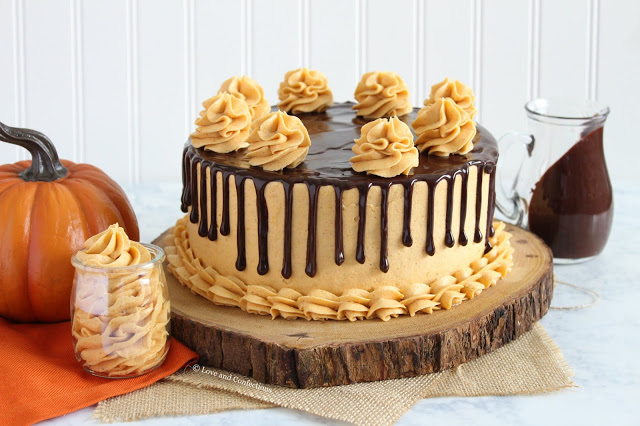 Chocolate pumpkin layer cake with spiced pumpkin frosting and chocolate ganache drip