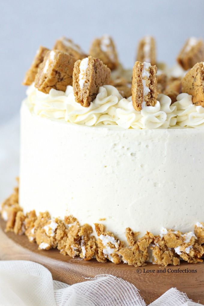 Oatmeal Cream Pie Layer Cake - oatmeal brown sugar layer cake, marshmallow frosting filling, and vanilla bean buttercream with oatmeal cream pie garnish
