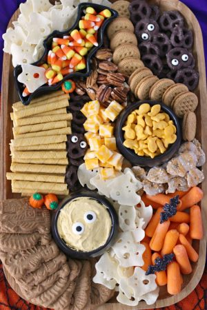 Kid-Friendly Halloween Snack Board featuring both store-bought and semi-homemade treats
